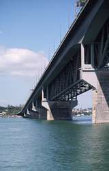 400826: Auckland Harbour Bridge North Island NZ City approach showing cantilevered road widening