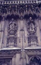 401337: Canterbury Kent England Statues of Anselm (left), and Thomas Cramner (right), on wall of Canterbury Cathedral